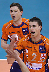 Alen Pajenk (front) and Andrej Flajs at 8th final volleyball match of CEV Indesit Champions League Men 2008/2009 between ACH Volley Bled (SLO) and Zenit Kazan (RUS), on February 12, 2009 in Hall Tivoli, Ljubljana, Slovenia. (Photo by Vid Ponikvar / Sportida)