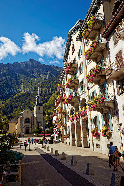 Street view of Hotel De Ville, Church, and the French Alps - Chamonix, France (Vertical).