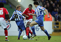 Photo: Paul Thomas.<br /> Chester City v Nottingham Forest. The FA Cup.<br /> 03/12/2005.<br /> <br /> Forests' Wes Morgan takes on Steward Drummond and Justin Walker.
