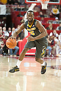 Feb 16, 2013; Fayetteville, AR, USA; Missouri Tigers guard Keion Bell (5) dribbles the ball during a game against the Arkansas Razorbacks at Bud Walton Arena. Arkansas defeated Missouri 73-71. Mandatory Credit: Beth Hall-USA TODAY Sports