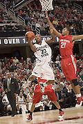 December 18, 2007: Cleveland State University's Joe Davis #23 goes to the basket against Ohio States Evan Turner #21 during the John McClendon Scholarship Classic in Cleveland, Ohio. Ohio State won the match 80-63. Michael Ciu.