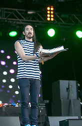 "Steve Aoki with his cake, playing the main stage, Saturday at Rockness 2013, the annual music festival which took place in Scotland at Clune Farm, Dores, on the banks of Loch Ness, near Inverness in the Scottish Highlands. The festival is known as ""the most beautiful festival in the world"" ."