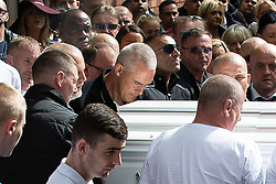 © Licensed to London News Pictures . Salford , UK . File picture of JOHN KINSELLA (centre with cropped grey hair and glasses) carrying Paul Massey's coffin at Paul Massey's funeral , in Salford , on 28th May 2015. Police have arrested several men in connection with the murders of both Kinsella and Massey. Photo credit : Joel Goodman/LNP