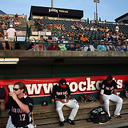 Brandon Waring, (left), heads to the field of play from the dugout during the New Britain Rock CatsFans in the stands during the New Britain Rock Cats Vs Binghamton Mets Minor League Baseball game at New Britain Stadium, New Britain, Connecticut, USA. 2nd July 2014. Photo Tim Clayton