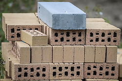 Embargoed to 0001 Thursday October 13 File photo dated 25/08/16 of bricks on a building site as the average brick sitting in a UK house is worth more than £47 - based on the property's overall value, research has found.
