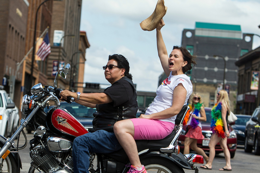 D Rojas drives Minneapolis Mayor Betsy Hodges to lead the 2015 Ashley Rukes GLBT Pride Parade in Minneapolis June 28, 2015.