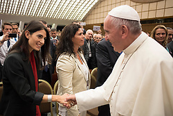 Pope Francis greets Rome's mayor Virginia Raggi, a participant ofSport at the Service of Humanity'sFirst Global Conference on Sport and Faith, which is being held in the Vatican.The event is being organized by the Pontifical Council for Culture. Photo by ABACAPRESS.COM