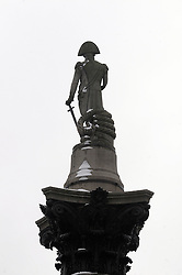 © Licensed to London News Pictures. 22/01/2013.Weather continues to stay cold today (22.01.2013).Nelson's column this morning with snow on.. Photo credit : Grant Falvey/LNP