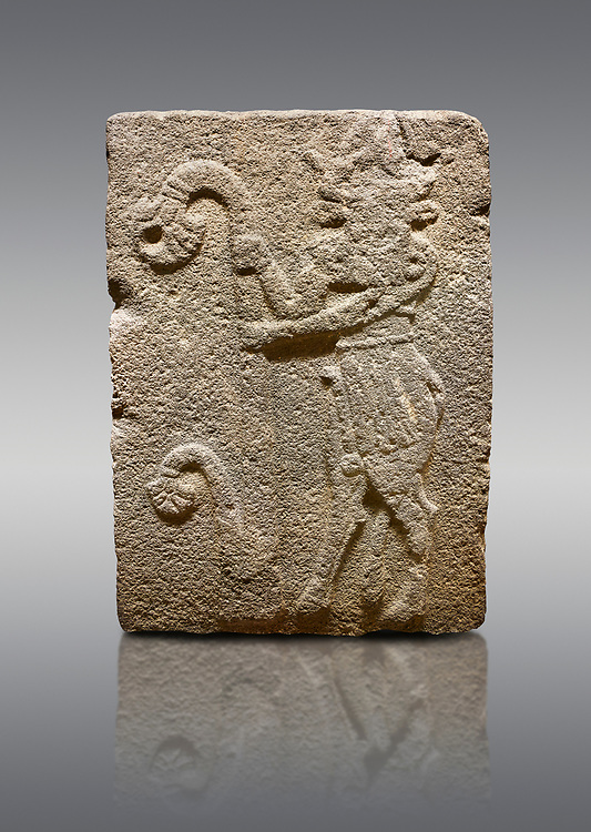 Picture & image of Hittite monumental relief sculpted orthostat stone panel from Water Gate Basalt, Karkamıs, (Kargamıs), Carchemish (Karkemish), 900-700 B.C. Anatolian Civilisations Museum, Ankara, Turkey. Bull-man holding the trunk of the tree. The waist-down part of the figure is in the form of a bull. <br /> <br /> On a gray background. .<br />  <br /> If you prefer to buy from our ALAMY STOCK LIBRARY page at https://www.alamy.com/portfolio/paul-williams-funkystock/hittite-art-antiquities.html  - Type  Karkamıs in LOWER SEARCH WITHIN GALLERY box. Refine search by adding background colour, place, museum etc.<br /> <br /> Visit our HITTITE PHOTO COLLECTIONS for more photos to download or buy as wall art prints https://funkystock.photoshelter.com/gallery-collection/The-Hittites-Art-Artefacts-Antiquities-Historic-Sites-Pictures-Images-of/C0000NUBSMhSc3Oo
