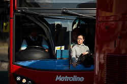 © Licensed to London News Pictures. 09/07/2015. London, UK. A woman looking out of a full bus at Victoria Station. Commuters stranded at Victoria Station in London on the day of a network wide tube strike which finishes at 9.30 this evening. Photo credit: Ben Cawthra/LNP