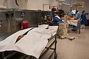 Forensic experts perform autopsies on victims of drug shootings and assignations at the Juarez City Forensic Lab in Juarez, Mexico January 16, 2009.  An ongoing drug war has already claimed more than 40 people since the start of the year. More than 1600 people were killed in Juarez in 2008, making Juarez the most violent city in Mexico.    (Photo by Richard Ellis)