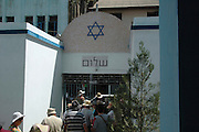 Yangon Myanmar. The Jewish Musmeah Yeshua Synagogue built in 1893. Tourists entering the building