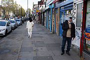 As Londoners from the mainly Asian community await the second coronavirus national lockdown it's business as usual at Bethnal Green Road Market with people out and about, some wearing face masks and some not, on what will be the few days of normality before a month-long total lockdown in the UK on 2nd November 2020 in London, United Kingdom. The three tier system in the UK has not worked sufficiently, to suppress the virus, and there have have been calls by politicians for a 'circuit breaker' complete lockdown to be announced to help the growing spread of the Covid-19.