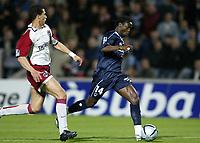Fotball<br /> Frankrike 2003/04<br /> Bordeaux v Paris Saint Germain<br /> 11. mai 2004<br /> Foto: Digitalsport<br /> NORWAY ONLY<br /> <br /> PASCAL FEINDOUNO (BOR) / MARA TALAL EL KARKOURI (PSG)