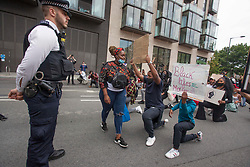 © Licensed to London News Pictures. 03/06/2020. London, UK. Black Lives Matter protestors rally in Hyde Park moved in front of US Embassy in central London following the death of George Floyd in Minnesota, USA . Photo credit: Marcin Nowak/LNP