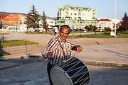 "Father Abdush preparing for a drum session on a stage in front of the ""House of Culture"" in Delcevo, Macedonia. The Roma family - father and his 3 sons - are well know for their drum perfomances and also they build their drums themselves."