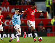 Phil Foden of Manchester City tackles Anthony Martial of Manchester United during the Premier League match at Old Trafford, Manchester. Picture date: 8th March 2020. Picture credit should read: Darren Staples/Sportimage