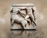 Sculpture of Lapiths and  Centaurs battling from the Metope of the Parthenon on the Acropolis of Athens No III. Also known as the Elgin marbles. British Museum London. .<br /> <br /> If you prefer to buy from our ALAMY STOCK LIBRARY page at https://www.alamy.com/portfolio/paul-williams-funkystock/greco-roman-sculptures.html . Type -    Elgin    - into LOWER SEARCH WITHIN GALLERY box - Refine search by adding a subject, place, background colour, etc.<br /> <br /> Visit our ROMAN WORLD PHOTO COLLECTIONS for more photos to download or buy as wall art prints https://funkystock.photoshelter.com/gallery-collection/The-Romans-Art-Artefacts-Antiquities-Historic-Sites-Pictures-Images/C0000r2uLJJo9_s0