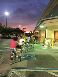 September 6, 2017 - Florida, U.S. - Customers looking for bottled water to stock up for Hurricane Irma lined up before opening time outside the Publix supermarket at 2724 W Hillsborough Ave. The store let them in early. (Credit Image: © Sue Carlton/Tampa Bay Times via ZUMA Wire)