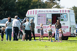 © Licensed to London News Pictures. 13/09/2020. St Helens, UK. People wait for ice cream as they enjoy a sunny day at Sherdley Park, St Helens. The UK is expecting a mini heatwave this week. Photo credit: Kerry Elsworth/LNP