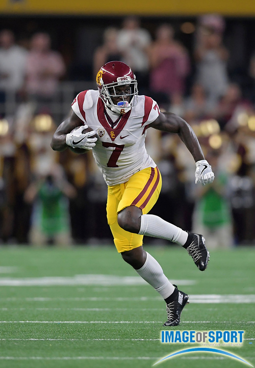 Sep 3, 2016; Arlington, TX, USA; USC Trojans wide receiver Steven Mitchell Jr. (7) runs with the ball during the first half against the Alabama Crimson Tide at AT&T Stadium.