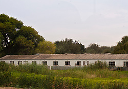 March 26, 2011 - Johannesburg, South Africa - Hostel barracks originally built to house black male migrant workers still are prevalent in Soweto (short for South West Township) sheltering people fleeing rural poverty..(Credit Image: © Arnold Drapkin/ZUMAPRESS.com)
