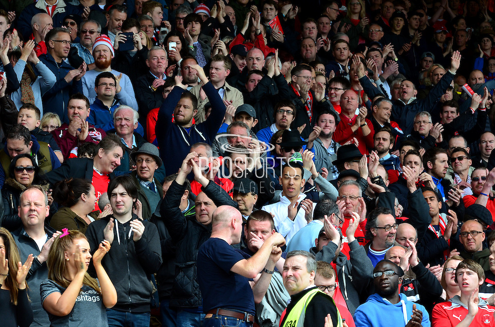 Leyton Orient fans applaud their players onto the pitch during the Sky Bet League 1 match between Swindon Town and Leyton Orient at the County Ground, Swindon, England on 3 May 2015. Photo by Alan Franklin.