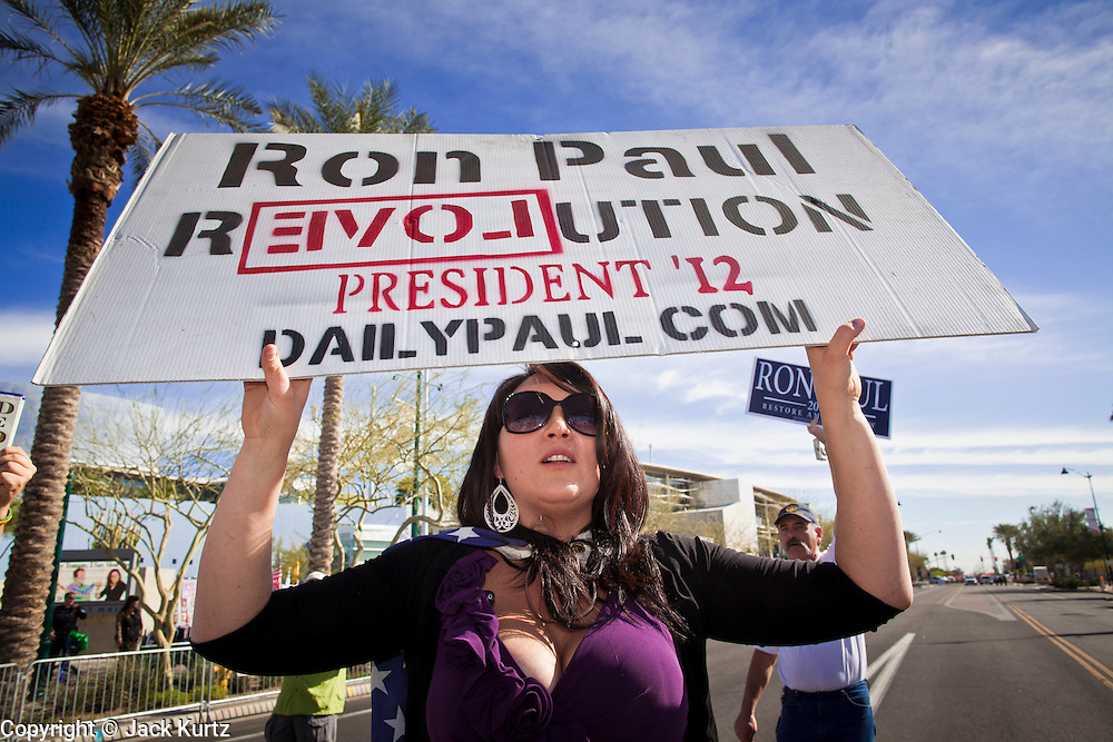 22 FEBRUARY 2012 - MESA, AZ: APRIL CARDENAS, from Mesa, AZ, rallies in support of Congressman Ron Paul in Mesa Wednesday. Ron Paul supporters had hundreds of people in front of the Mesa Arts Center before CNN's Arizona Republican Presidential Debate Wednesday.     PHOTO BY JACK KURTZ