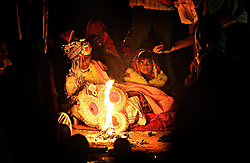 Rajani, 5, and her boy groom, Kaushal, barely look at each other as they are married in front of the sacred fire. By tradition, the young bride is expected to live at home until puberty, when a second ceremony transfers her to her husband.