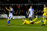 A headed shot at goal is blocked by James Clarke (15) of Bristol Rovers during the EFL Sky Bet League 1 match between Bristol Rovers and AFC Wimbledon at the Memorial Stadium, Bristol, England on 23 October 2018.
