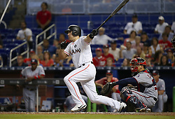 June 21, 2017 - Miami, FL, USA - Miami Marlins catcher J.T. Realmuto reaches on a missed catch error by Washington Nationals first baseman Adam Lind during the eighth inning on Wednesday, June 21, 2017 at Marlins Park in Miami, Fla. (Credit Image: © David Santiago/TNS via ZUMA Wire)