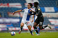 Lewis Travis of Blackburn Rovers and Taylor Richards of Doncaster Rovers contest a loose ball  during the EFL Cup match between Blackburn Rovers and Doncaster Rovers at Ewood Park, Blackburn, England on 29 August 2020.