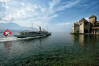 A Lake Geneva Boat Cruise pulling into The Château de Chillon Chillon Castle. An architectural jewel located in the most beautiful setting imaginable - on the shores of Lake Geneva, right at the foot of the Alps.