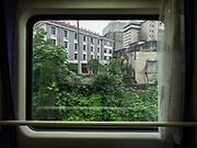 The suburbs of Changsha. Window view across China, from Hong Kong to Urumqi, Xinjiang.
