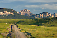 Gravel road approaching the Rocky Mountain Front Range near Choteau Montana