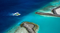 Aerial view of harbour  entry of Keyodhoo, Vaavu Atoll, Maldives, Indian Ocean with speedboat coming in