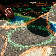 A street artist draws with chalk near the Space Needle in Seattle, Washington.