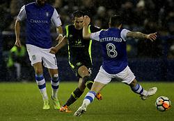 Carlisle united's Luke Joyce and Sheffield Wednesday's Jacob Butterfield battle for the ball