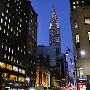An exterior night shot of Grand Central Terminal showing the Chrysler Building in Manhattan, New York, USA.  Photo Tim Clayton