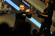 Stephen Maguire of Scotland celebrates his win as he lifts the trophy.  Welsh open snooker  pic by Andrew Orchard,