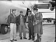 Captains F. Sabol and W.Hewitt, two of the U.S. crew members who flew out the Irish 32nd Battalion to the Congo, pictured chatting before take-off with Irish Army man Seán Mc Allister and J. Donnelly at Baldonnel Aerodrome..27.07.1960