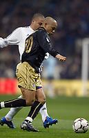 7/2/2004 Madrid, Spain.<br />La Liga (Spanish League) stage 23<br />R.Madrid 2 - Malaga 1<br />R.Madrid's Ronaldo in duel with Malaga's Edgar at Santiago Bernabeu's Stadium.<br />© 2004 Alejandro leon Fernandez