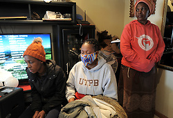 South Africa - Cape Town - 31 July 2020 - (Centre-Grey top- Veliso Bukwana, 44, friend) Family and friends at the home of Family of three, Mother Nomaphelo Kebe, (45) who was shot and killed at their home in Mfuleni. Wendy Kebe, 23, daughter and Sive Kebe, 17, son also died.  Picture: Brendan Magaar/African News Agency(ANA)
