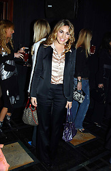 KELLY BROOK at a party to celebrate a new collection of sexy underware by Janet Reger called 'Naughty Janet' held at 5 Cavendish Square, London on 19th October 2004.<br />