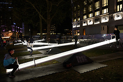 "© Licensed to London News Pictures. 05/10/2016. Visitors play on 'Impulse', part of the ""Pause and Play"" series comprising of 15 interactive acoustic, light up see-saws that  illuminate and produce sound when in motion.<br /> London, UK. Photo credit: Ray Tang/LNP"