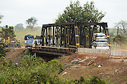 Vehicles cross a bridge intended for trains opened to road traffic to replace a  bridge that collapsed due to heavy rains near Notse, Togo on Thursday October 2, 2008.