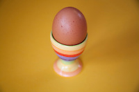Boiled egg in colourful egg cup