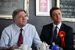 © Licensed to London News Pictures . 11/04/2015 . Bury , UK . Labour Shadow Chancellor Ed Balls and James Frith , Labour candidate for Bury North , at a campaign stop at Barista coffee shop at The Rock , Bury in Greater Manchester , UK . The pair met parents and discussed family finances . Photo credit : Joel Goodman/LNP
