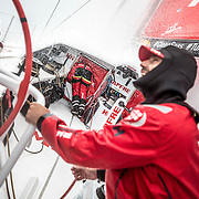 Leg 02, Lisbon to Cape Town, day 17, on board MAPFRE, Sophie Ciszek at the hatch waking up Antonio Cuervas-Mons and Tamara Echegoyen for the next watch, mean while Xabi Fernandez talking with Pablo Arrarte. Photo by Ugo Fonolla/Volvo Ocean Race. 21 November, 2017