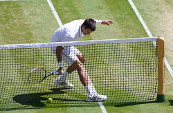 04.07.2014, All England Lawn Tennis Club, London, ENG, ATP Tour, Wimbledon, im Bild Novak Djokovic (SRB) ends up in the net during the Gentlemen's Singles Semi-Final match on day eleven // during the Wimbledon Championships at the All England Lawn Tennis Club in London, Great Britain on 2014/07/04. EXPA Pictures © 2014, PhotoCredit: EXPA/ Propagandaphoto/ David Rawcliffe<br /> <br /> *****ATTENTION - OUT of ENG, GBR*****